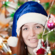 Girl in blue Christmas hat — Stock Photo #6854259