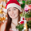 Girl in red Christmas hat — Stock Photo #6854264