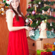 Woman near Christmas tree — Stock Photo #6854265