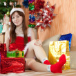 Girl with christmas gifts — Stok fotoğraf