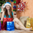 Girl in christmas gifts — Stock Photo
