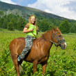 Girl riding a horse bareback - Foto Stock