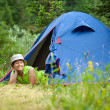 Woman lying in camp tent — Stock Photo