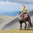 Rider with backpack on horseback - Foto Stock