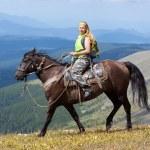 Female tourist on horseback — Stock Photo