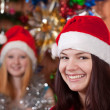 Girls in Christmas hats — Stock Photo