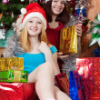 Girls  with christmas gifts — Stok fotoğraf