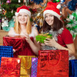 Stock Photo: Girls with christmas gift