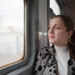 Woman passanger sitting inside train — Stok fotoğraf