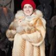 Woman chooses fur coat — Stock Photo