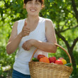 Stock Photo: Happy woman with vegetables