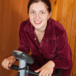 Woman exercise on exercycle — Stok fotoğraf