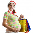 Pregnant woman holding shopping bags — Stock Photo