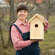 Woman with new birdhouse — Stock Photo #6854719