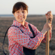 Happy female farmer in field — Stock Photo