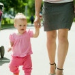 Happy toddler walking on road — Stock Photo