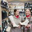 Women shopping at shoes shop — Stock Photo