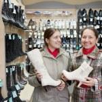 Women shopping at shoes shop — Stock Photo