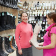 Women chooses high shoes at shop — Stock Photo #6854824