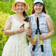 Two women with garden tools — Stock Photo #6854840