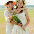 Two happy women in summer field — Stock Photo