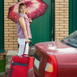 Happy woman with luggage — Stock Photo #6854893