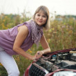 Womtrying to fix car — Stock Photo #6854895
