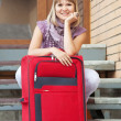 Happy woman with luggage — Stock Photo #6854921