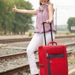 Woman waiting train on railroad — Stock Photo