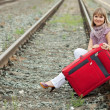 Woman with luggage — Stock Photo