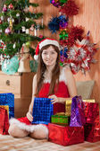 Girl with christmas presents — Stock Photo