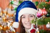 Girl in blue Christmas hat — Foto de Stock