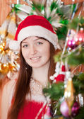 Girl in red Christmas hat — Stock Photo
