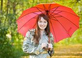 Girl with umbrella in autumn — Stock Photo