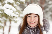 Smiling girl in wintry park — Stock Photo