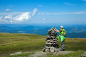 Mountains tourist making stone pile — Stock Photo