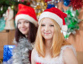 Girls in santa hats in christmas eve — Stock Photo