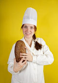 Baker is showing fresh bread — Stock Photo