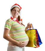 怀孕的女人举行购物袋 — 图库照片