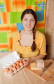 Young woman with bacon and eggs — Stock Photo