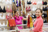 Buye at counter in underwear shop — Stock Photo