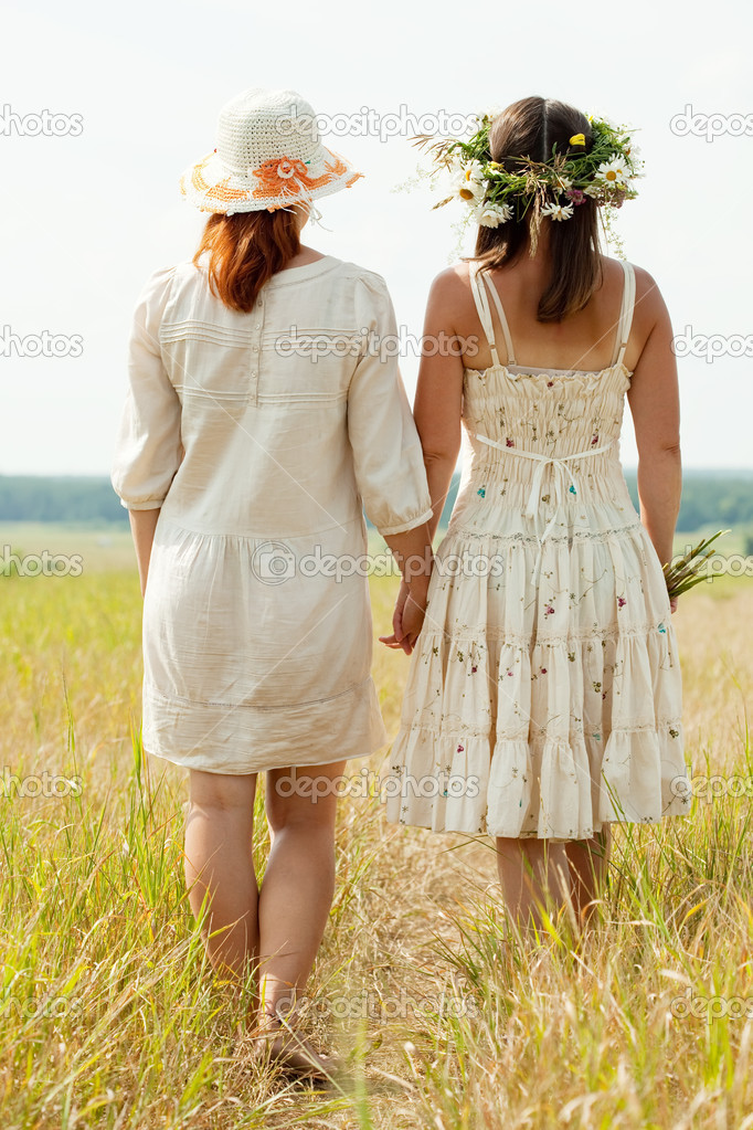 Rear view of two women on summer field — Stock Photo #6854865