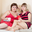 Relaxed women sitting on sofa — Stock Photo #6874764