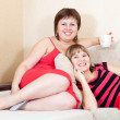 Women having fun with cups of tea — Stock Photo