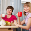 Women have tea in kitchen — Stock Photo #6874782