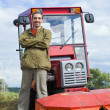 Farm worker with tractor — Stock Photo