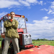 Stock Photo: Farm worker with tractor
