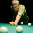 Man aiming for billiard table — Stock Photo