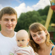 Father and mother with baby — Stock Photo #6874921