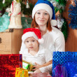 Mother and son with Christmas gifts — Stock Photo #6874937